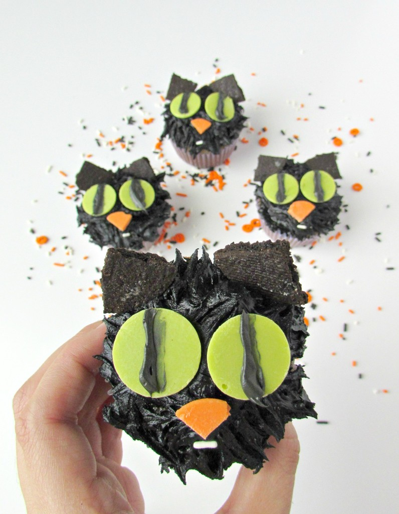 Creepy cute black cat cupcakes with big green eyes. Perfect for Halloween. - Val Event Gal