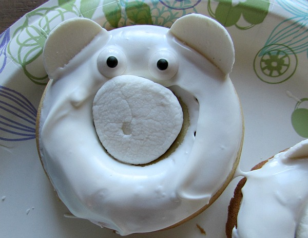 put on candy eyes or draw on with writing icing