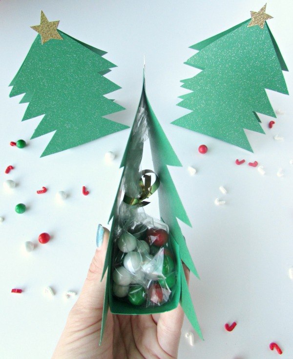 A Christmas Tree made of paper with a spot for treats inside