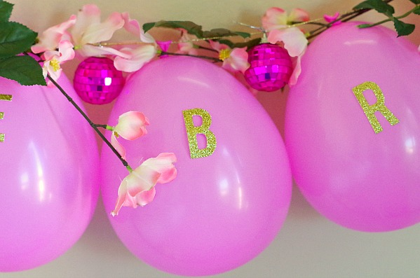glitter letters on pink balloon garland
