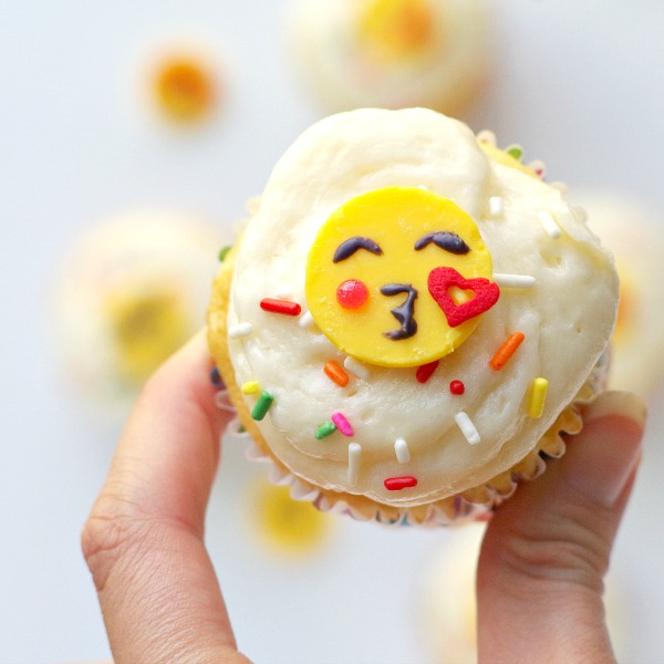 blowing kiss emoji cupcake