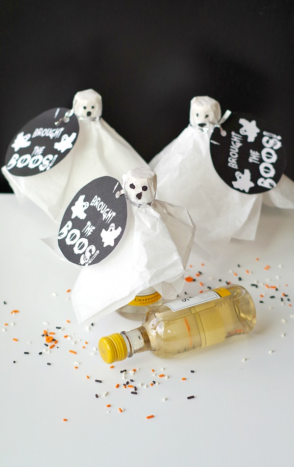 DIY Wine Ghosts. Dress up Halloween drinks.