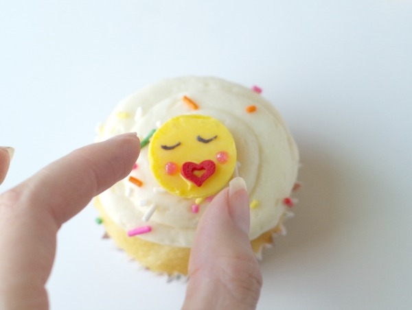 put emoji face on cupcake