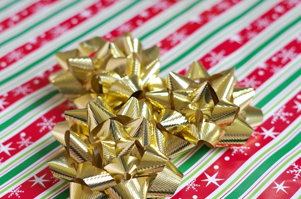 Christmas bows on wrapping paper