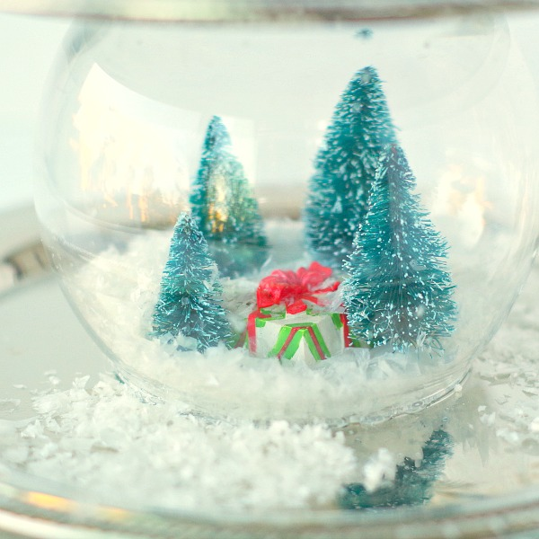 present and trees snow globe