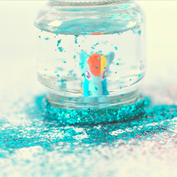 Small glitter toy snow globe