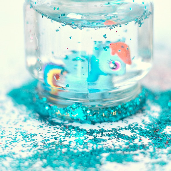 Snow globe made with kids toys and glitter