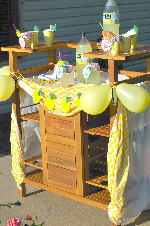 Yellow colorful lemon themed lemonade stand