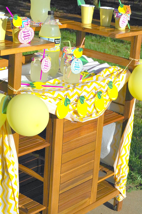 Fun yellow and white colorful lemonade stand with free printable